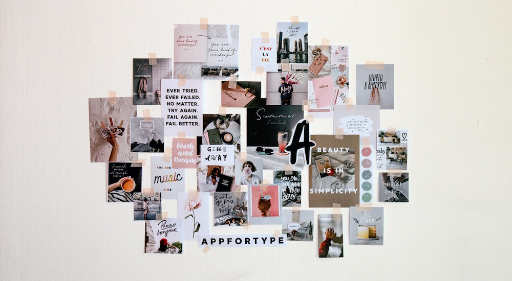 A collage of images and ideas pinned to a wall