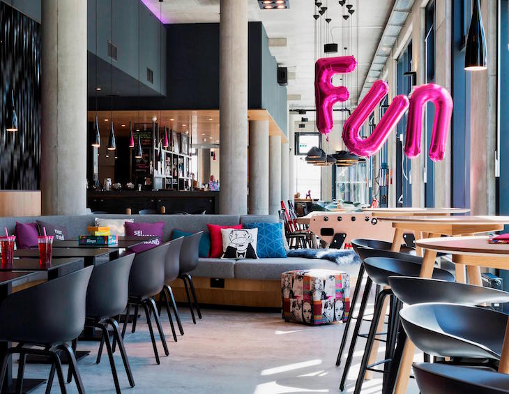 A fun living area inside Moxy Hotels with industrial design