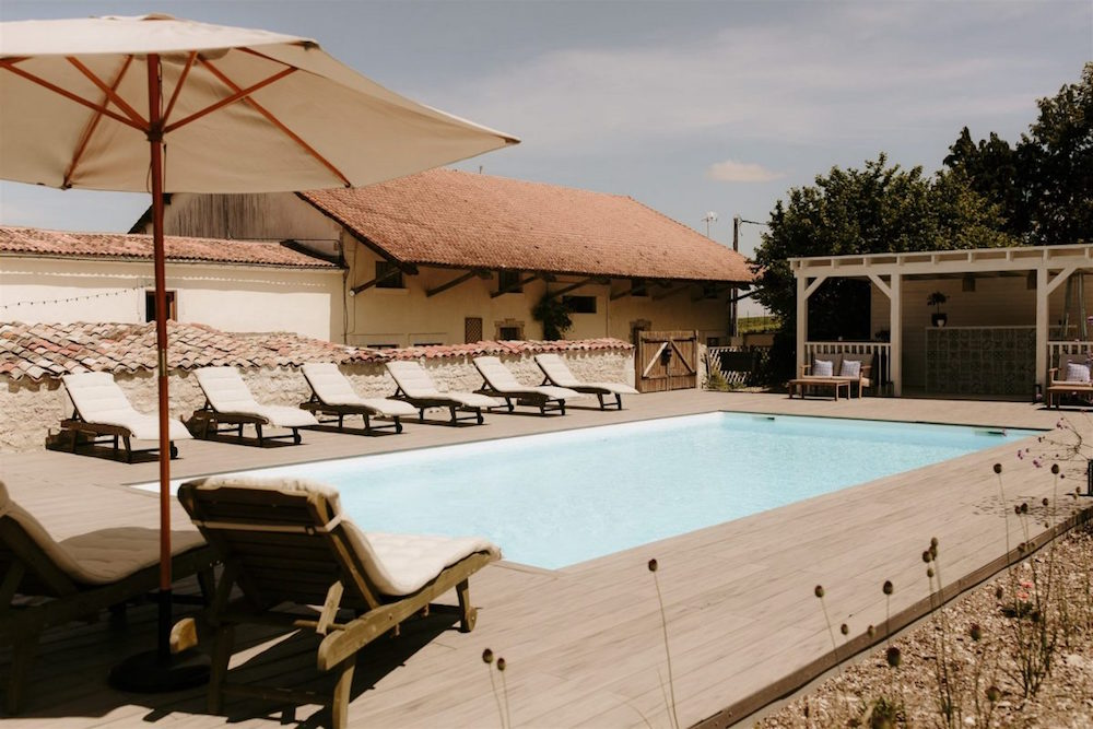 An outdoor pool iun between barns in La Vue