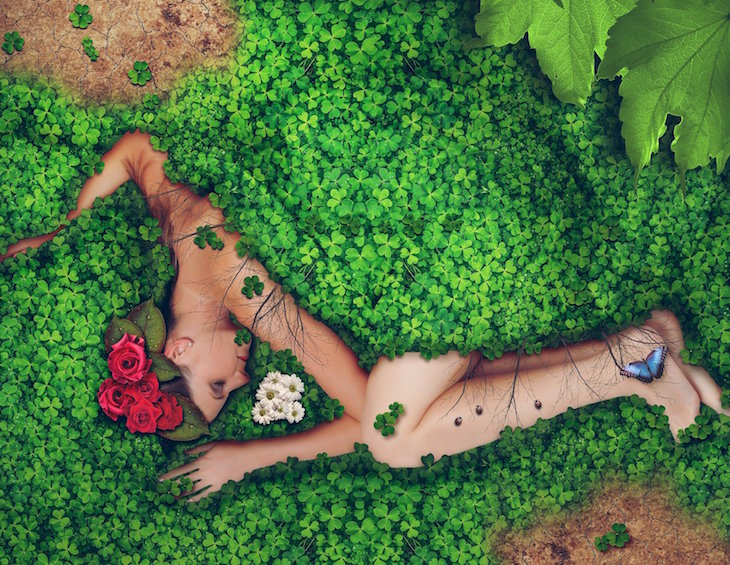 Woman lying in a greenery