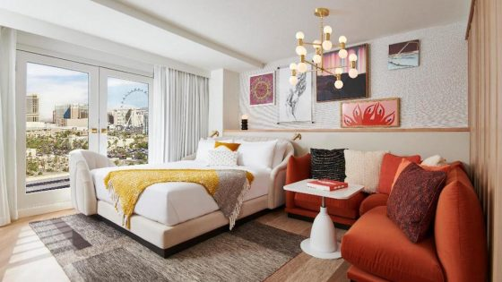 A render of a hotel room inside the Virgin Hotels property with views of The Strip of Las Vegas