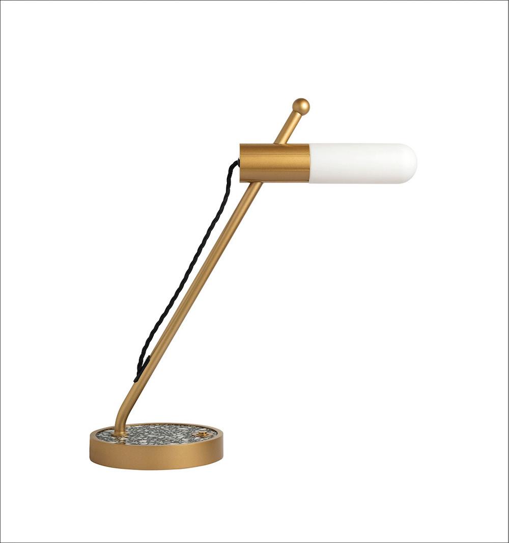 A contemporary gold desk light