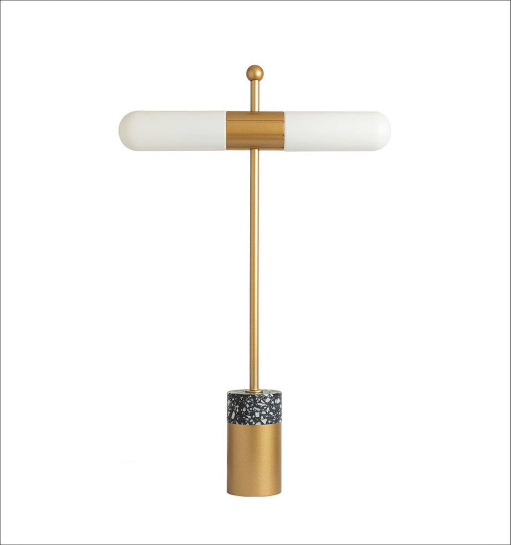 A gold desk light with two bulbs