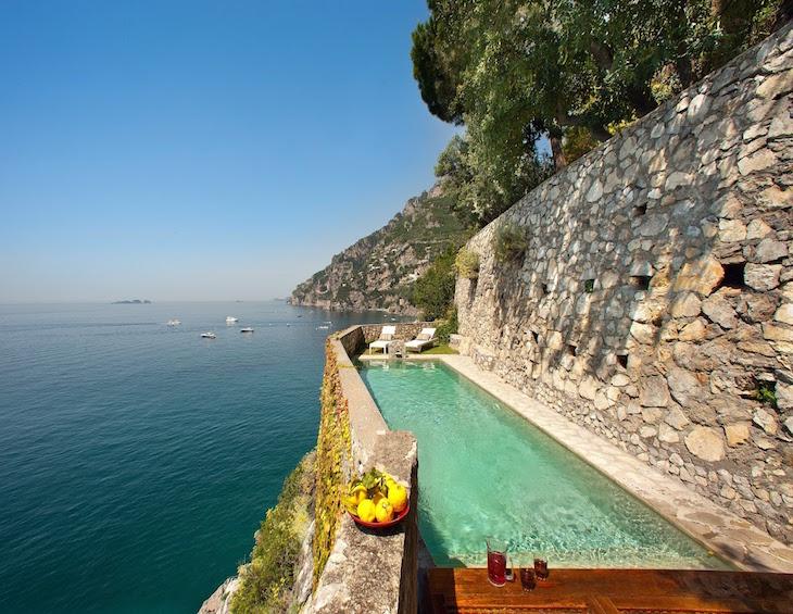 a long pool overlooking the Amalfi Coast