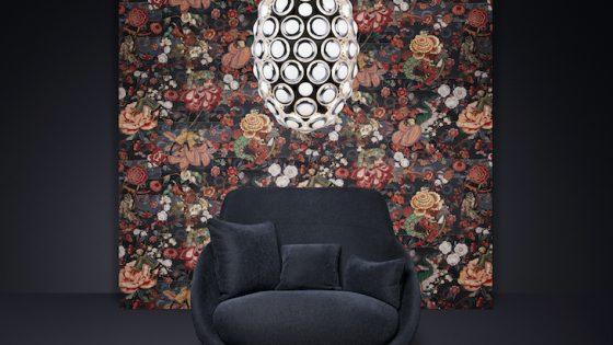 An artistic wallcovering behind blue armchair