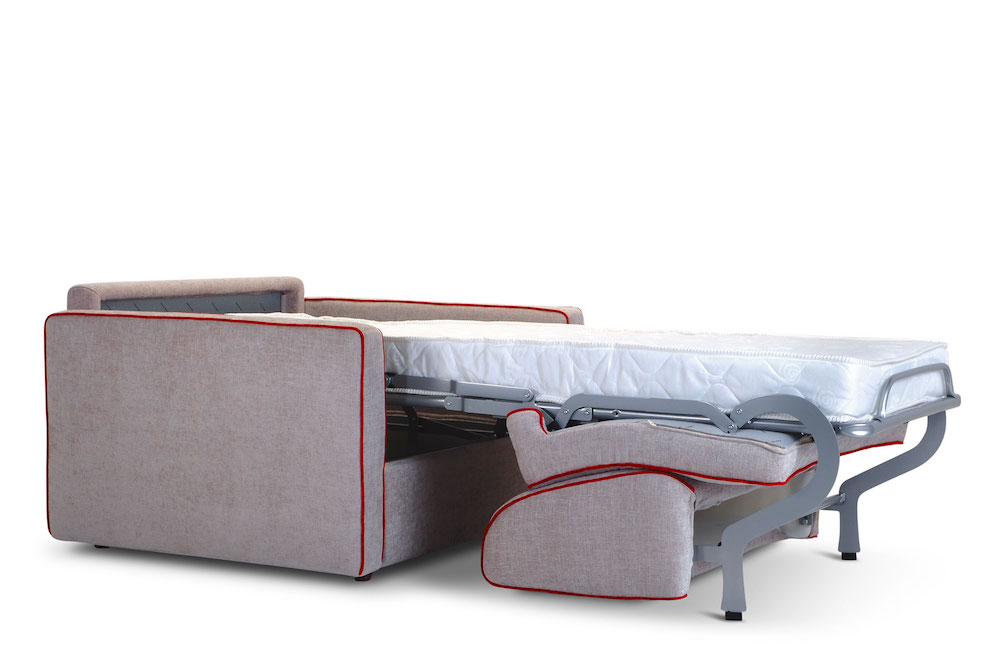 An armchair transformed into a single bed