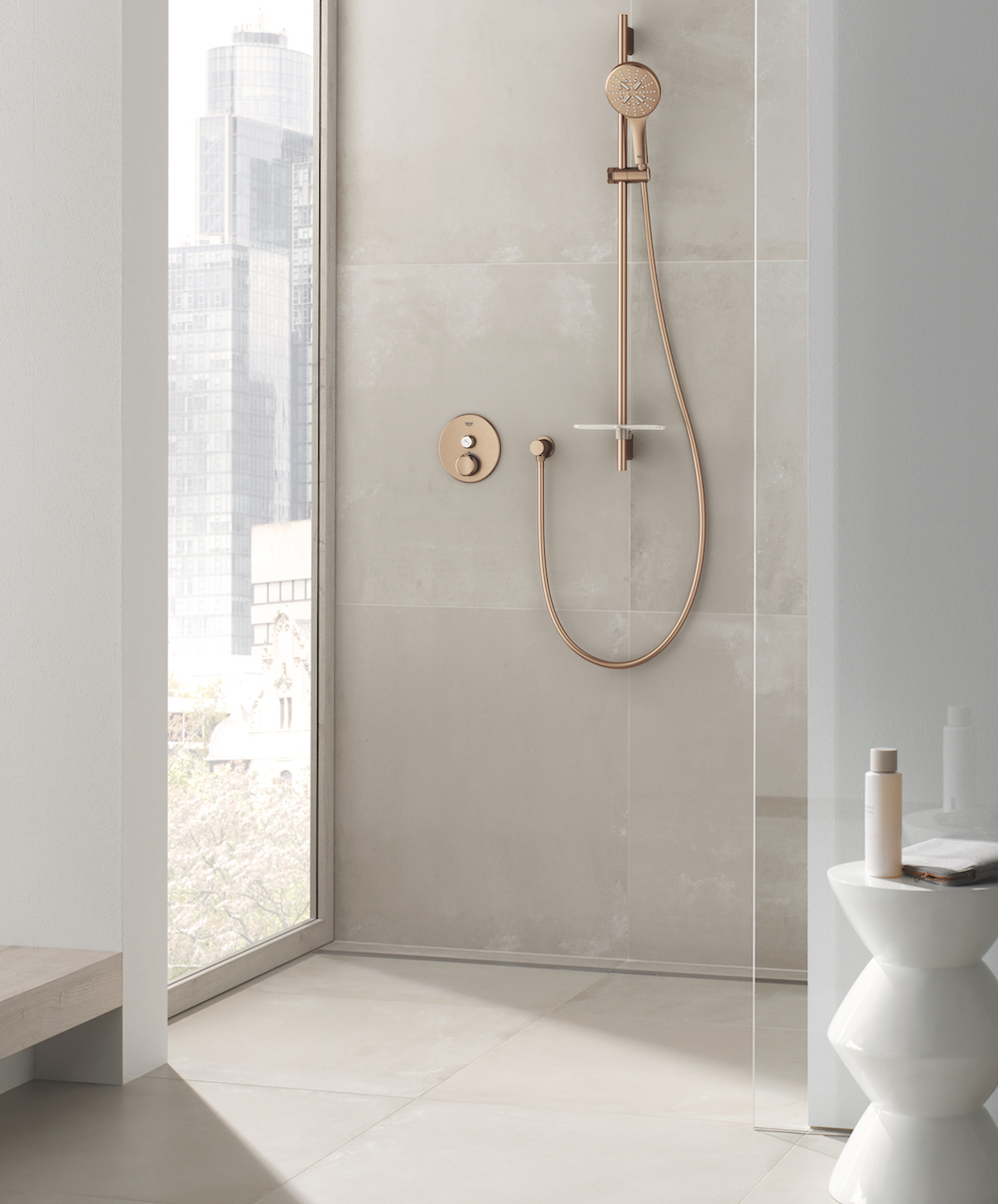 GROHE bathroom lifestyle shot featuring NEW GROHE Rainshower SmartActive 130 handshower