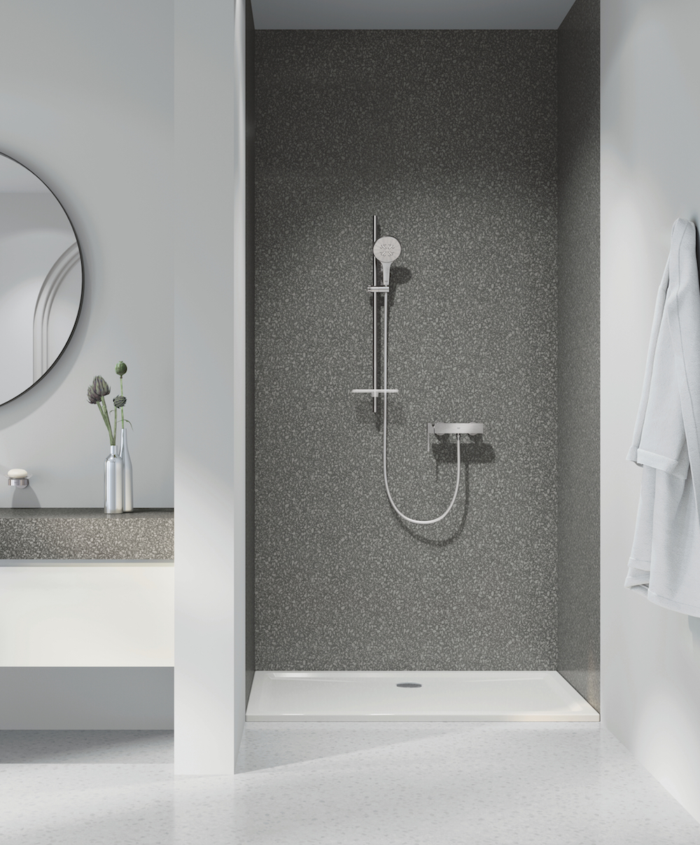 GROHE bathroom lifestyle shot featuring brassware from GROHE's Plus range and NEW Rainshower SmartActive 130 handshower