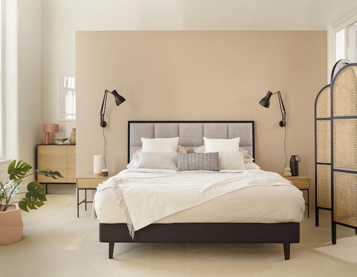 A modern bed with black lighting