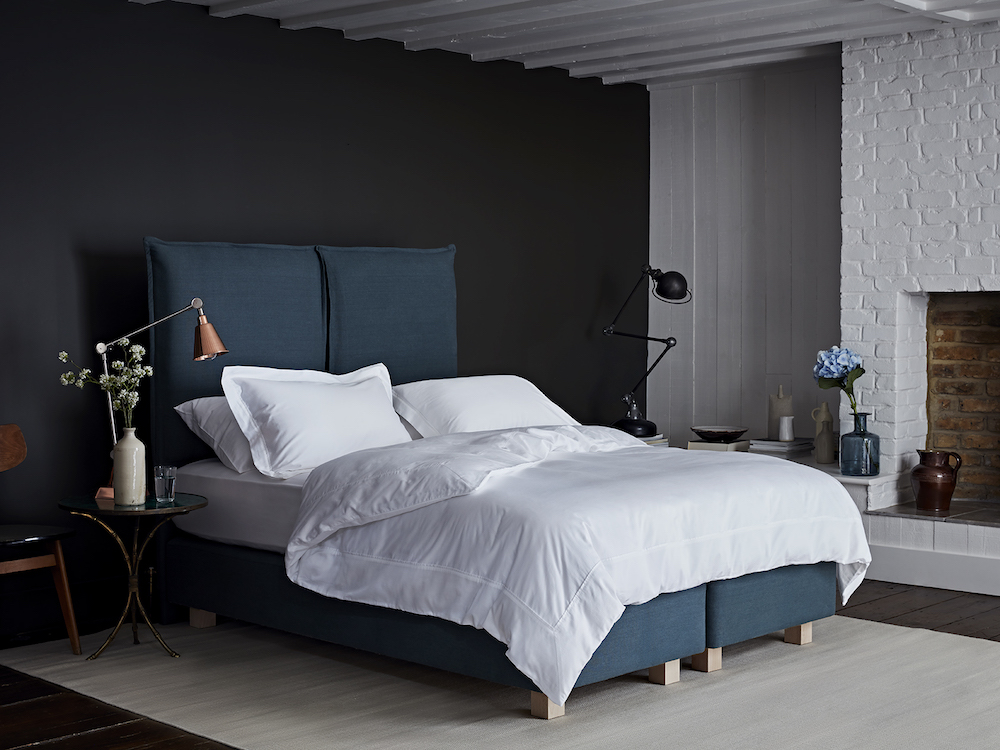 A blue bed in a modern room