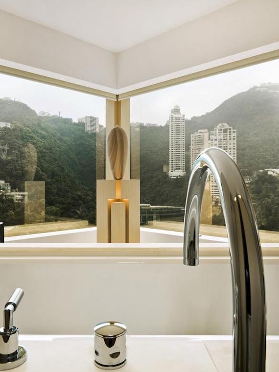 An image of a bathroom overlooking Hong Kong in The Upper House