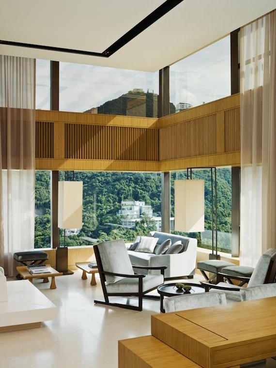 A modern living room in a suite inside The Upper House