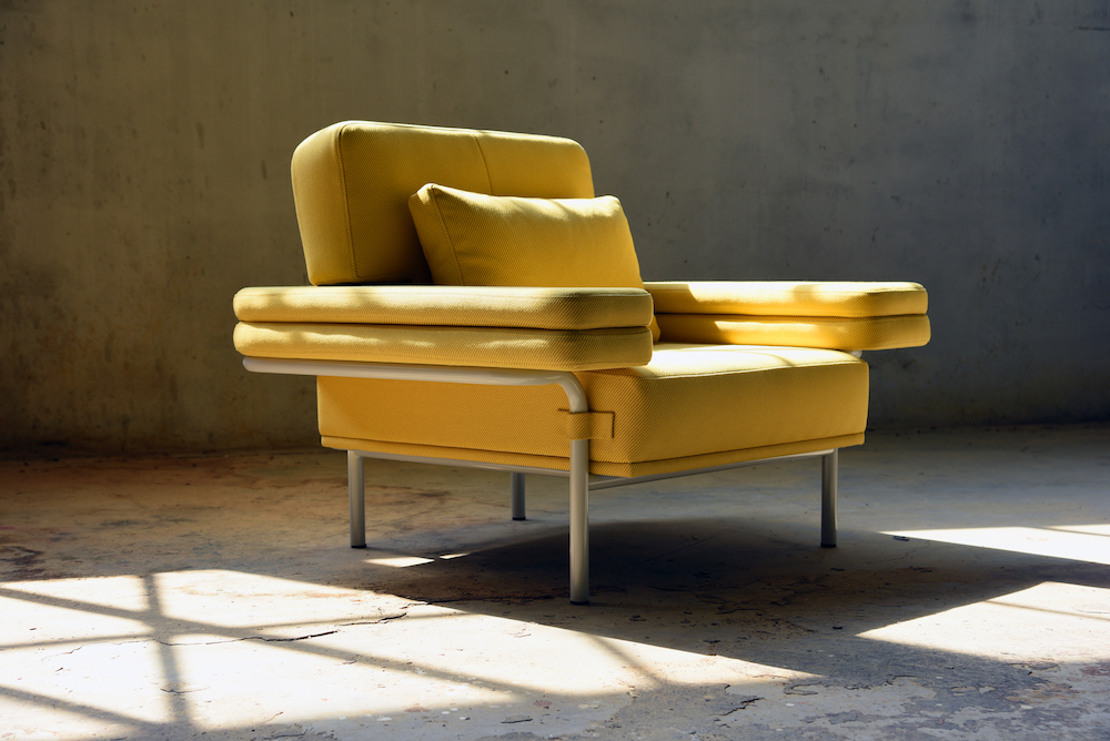 A yellow armchair within the LEO eco furniture collection