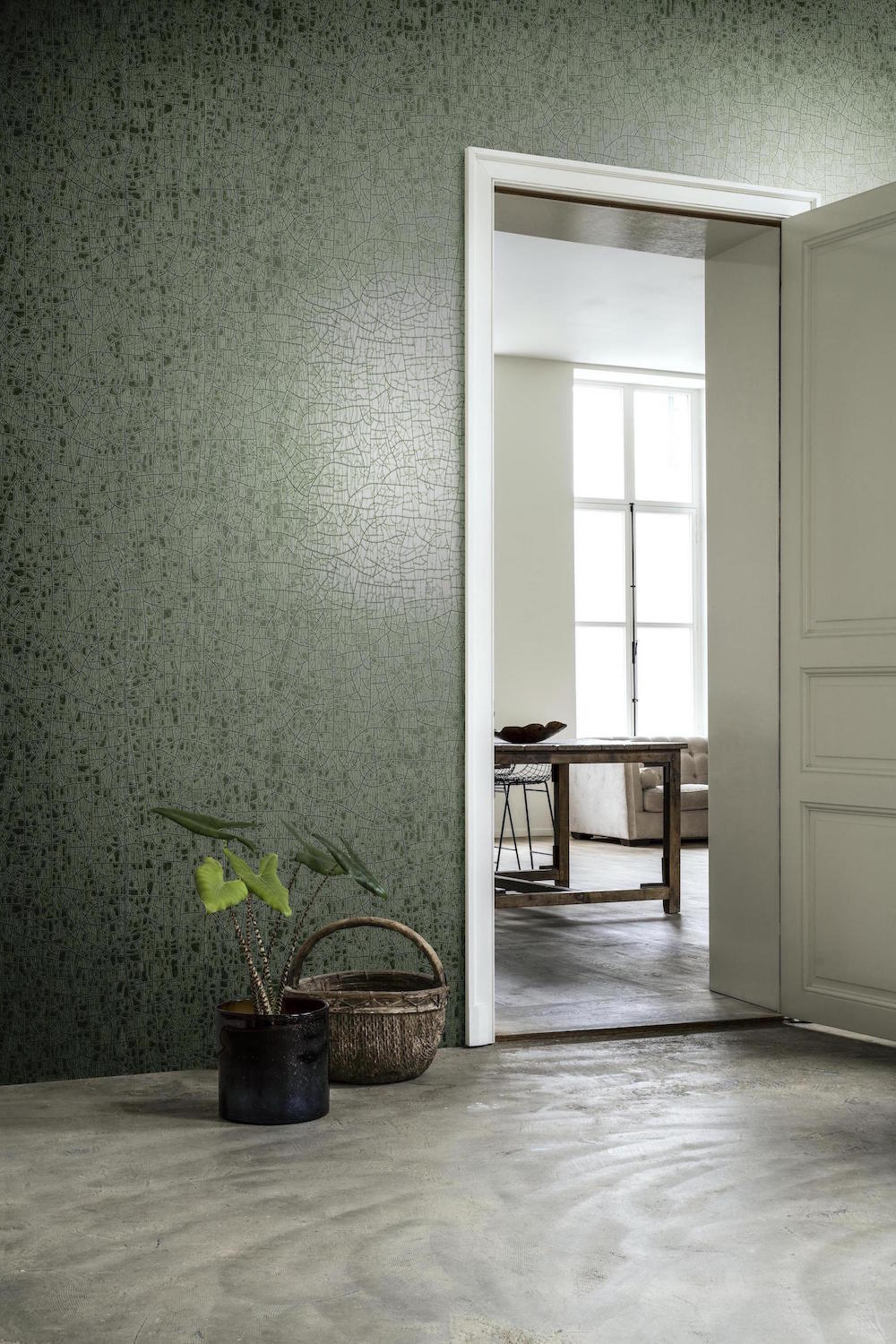 A bare room featuring Arte wallcovering