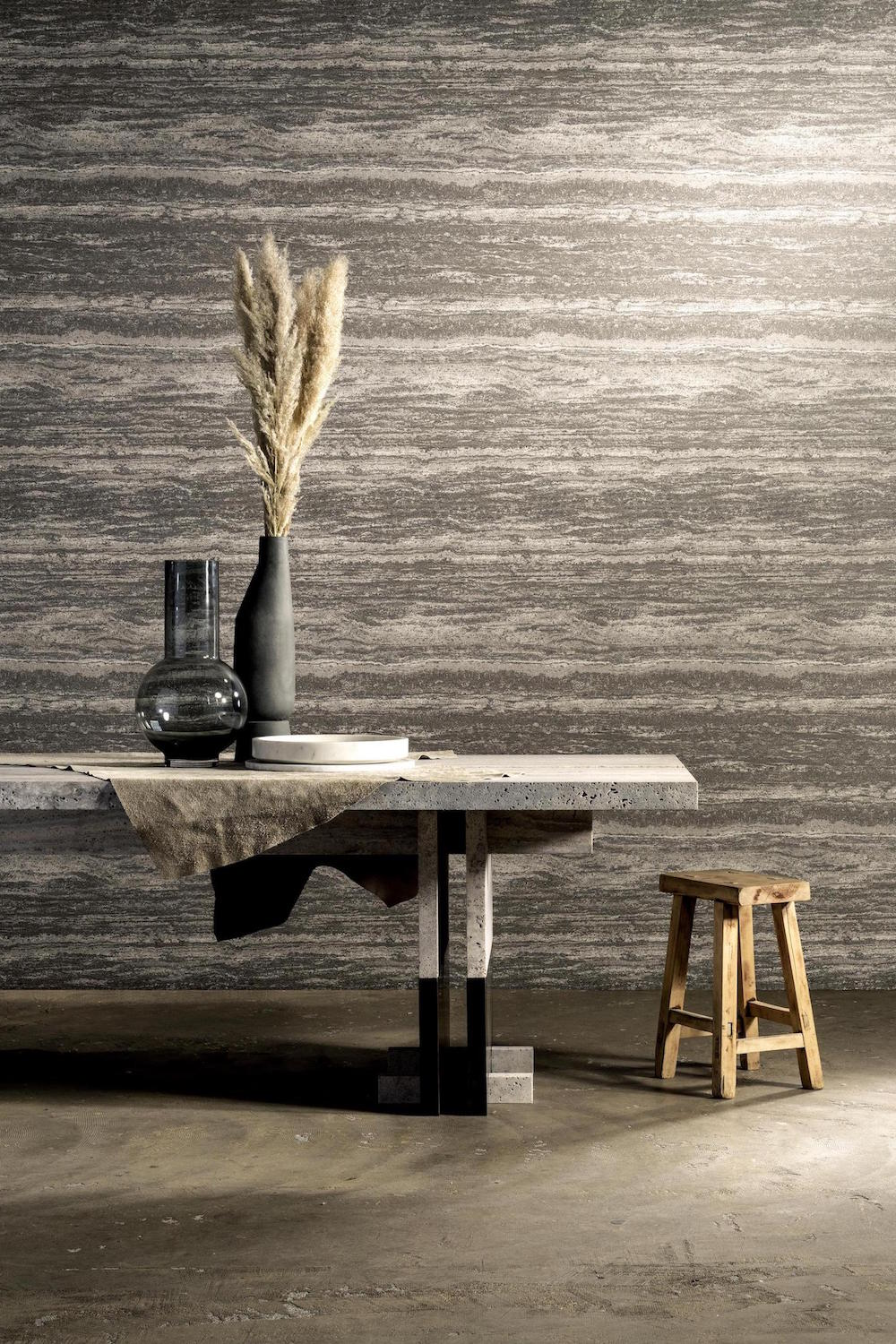 A large industrial table and wallpaper from Arte