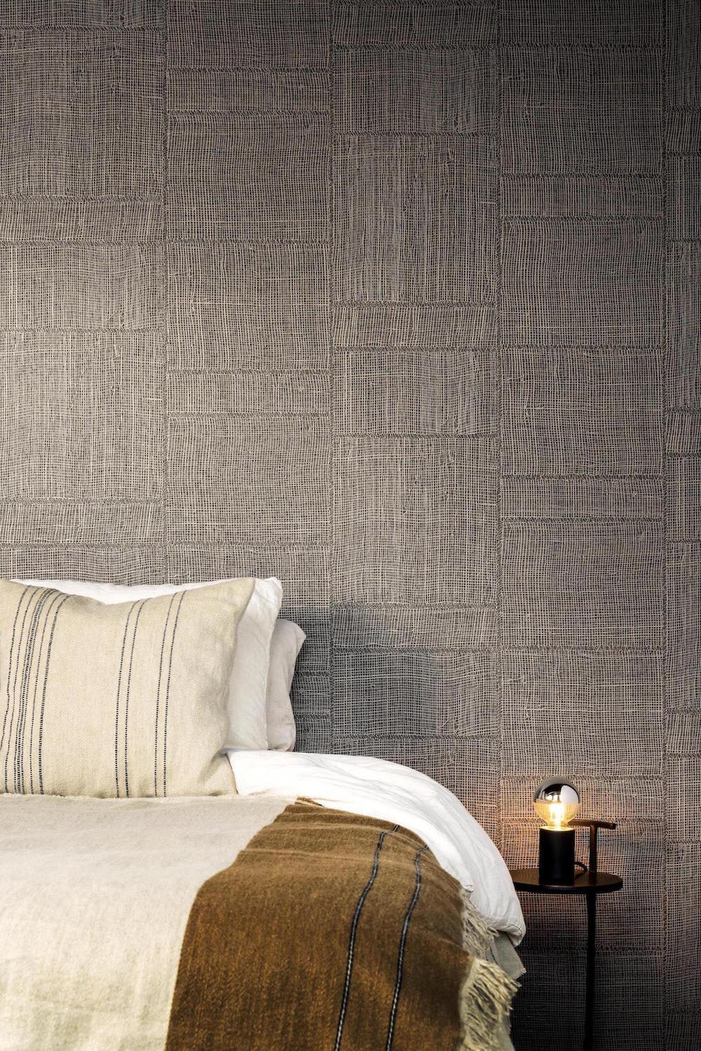 A bar guestroom with textured wallpaper