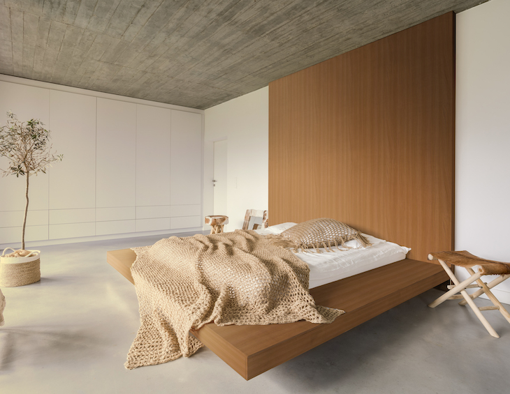 Light sustainable bedroom with wooden ceiling and large bed