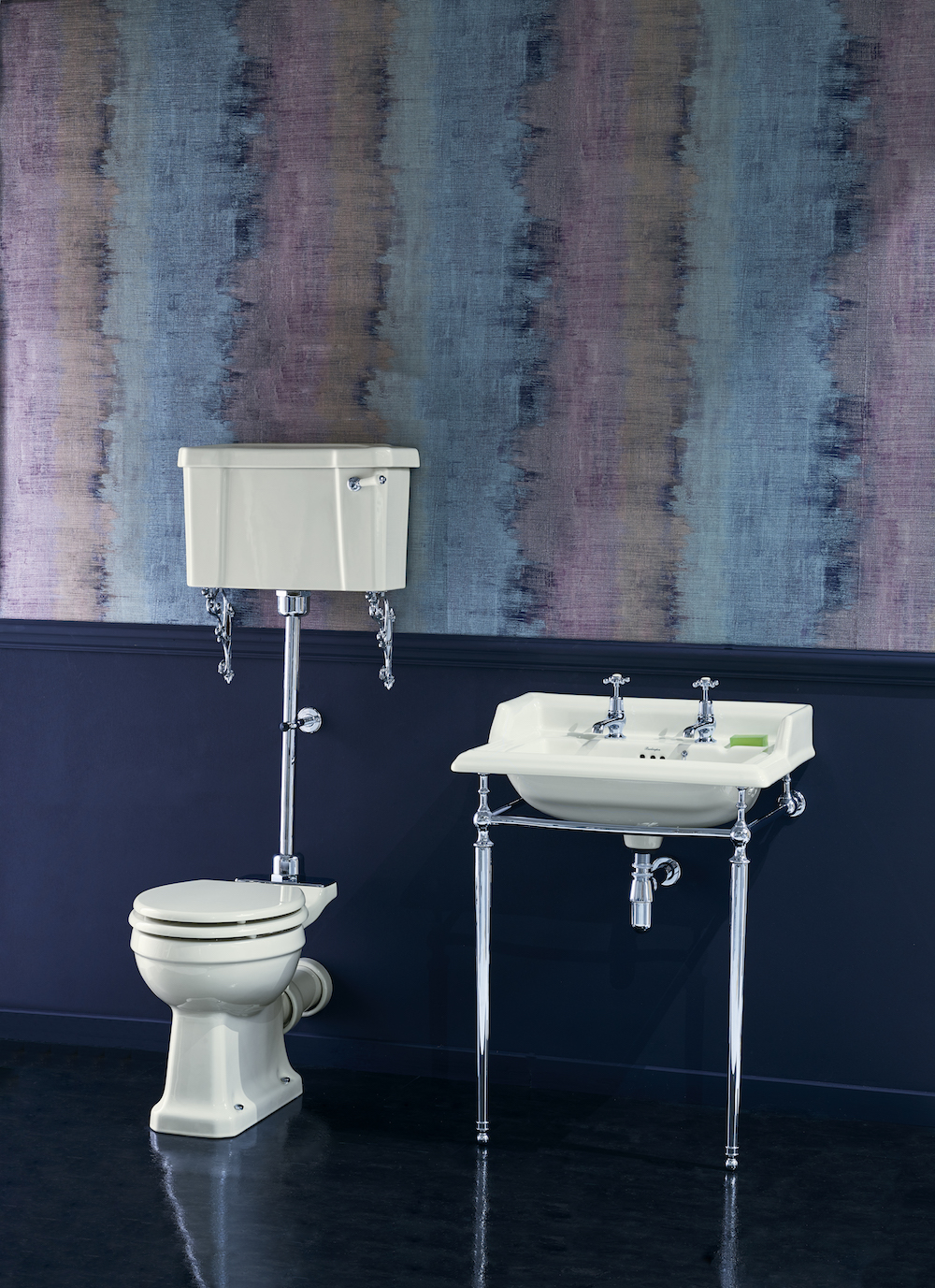 A white traditional toilet and basin