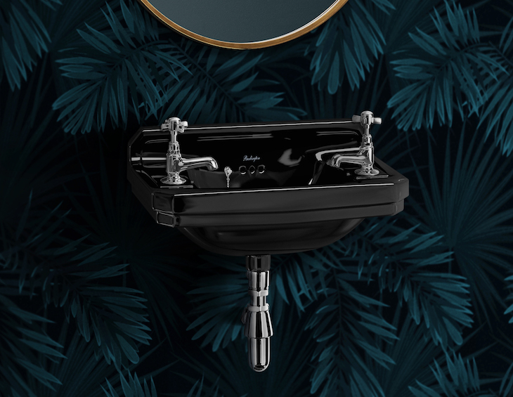 Black sink and dark patterned wallcover