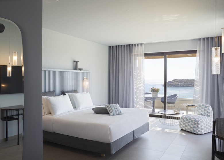 A modern and stylish guestroom inside CAYO Exclusive Resort and Spa