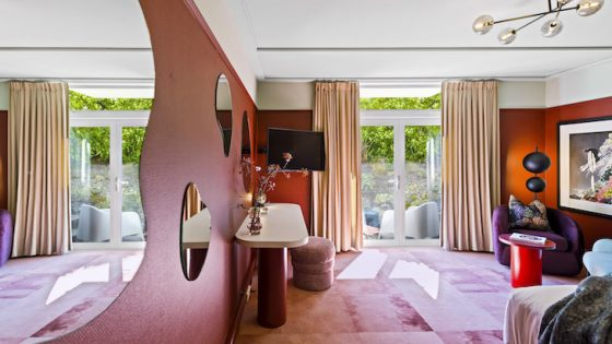 A pink room full with maximalist design