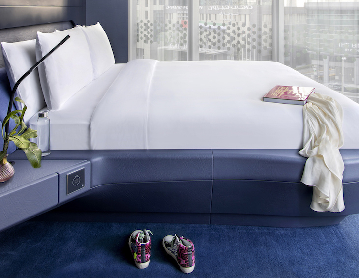 Image of shoes by the modern bed