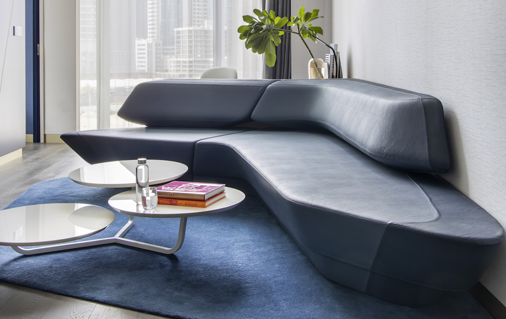 Image caption: A ZHA designed sofa in one of the Midnight Blue themed suites in the hotel.
