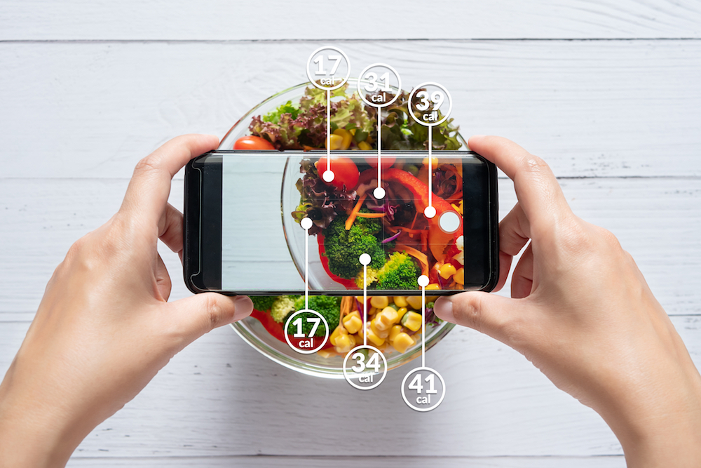An image of a person taking a picture of healthy food