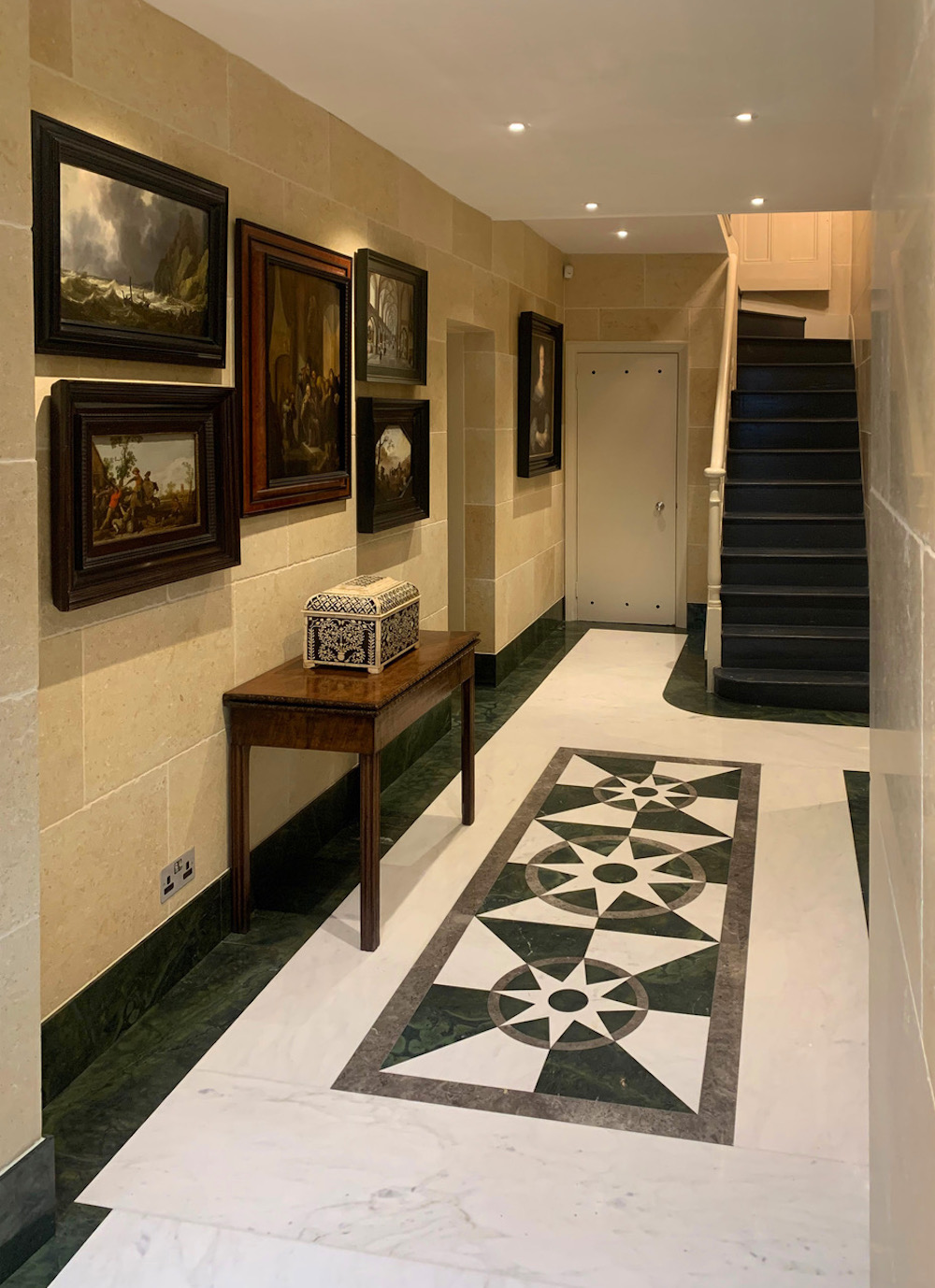 Image caption: A recent project, the basement of a house. The driver for this project was the client's artwork, which can be seen on the walls.