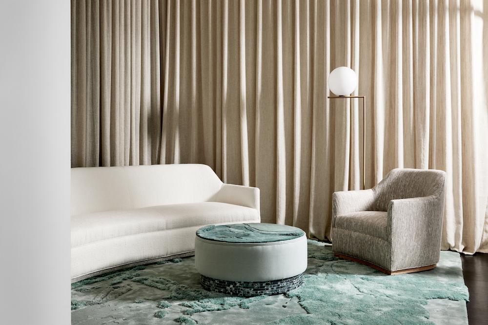 Image of green carpet and cream sofa