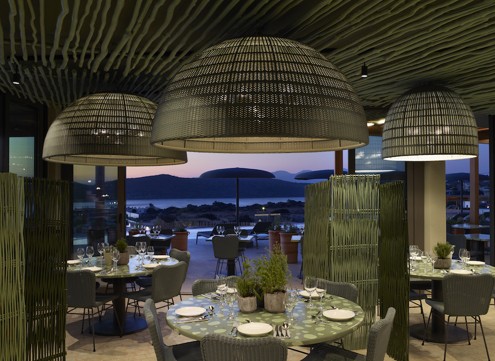 image of wicker light shades in contemporary restaurant in the CAYO hotel in Crete
