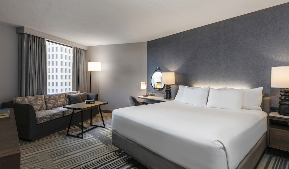 Image of stylish king bedroom in Hyatt Regency Houston