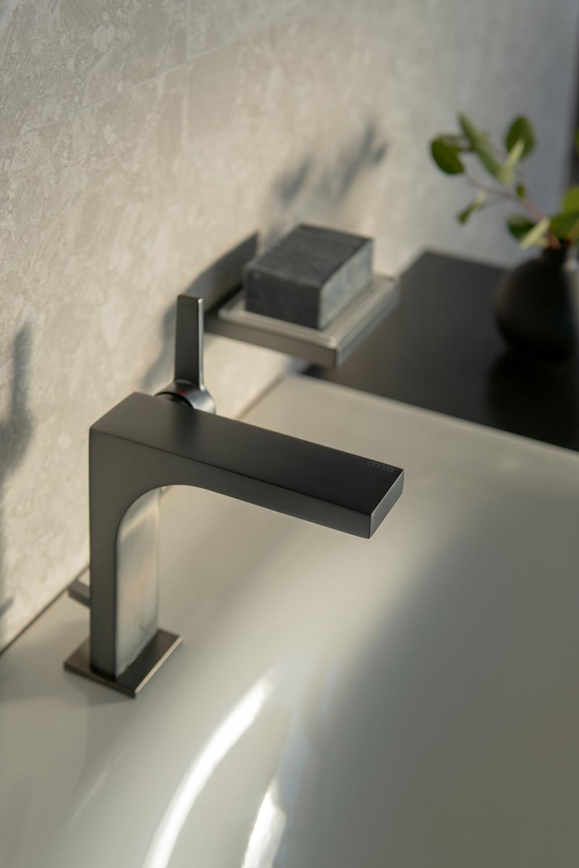 Close up of a matt black tap