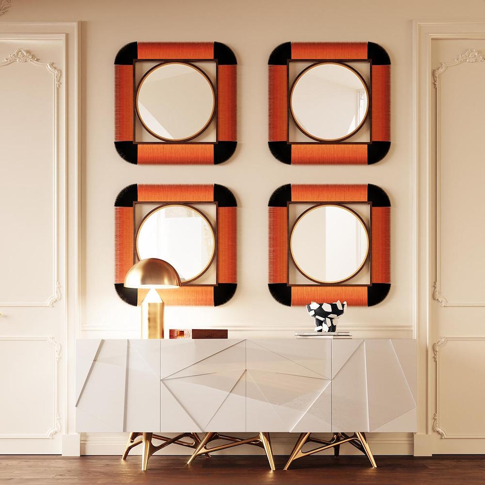 Moritz mirror hanging on wall