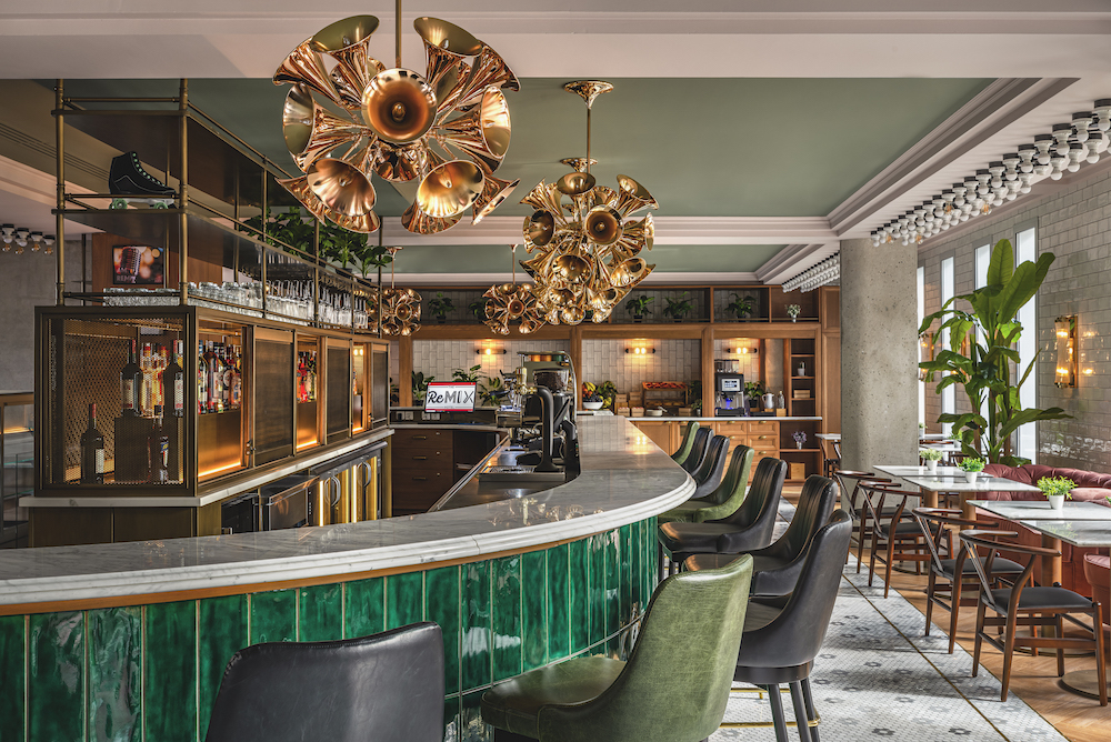A bold bar with green and gold explored in the interior design