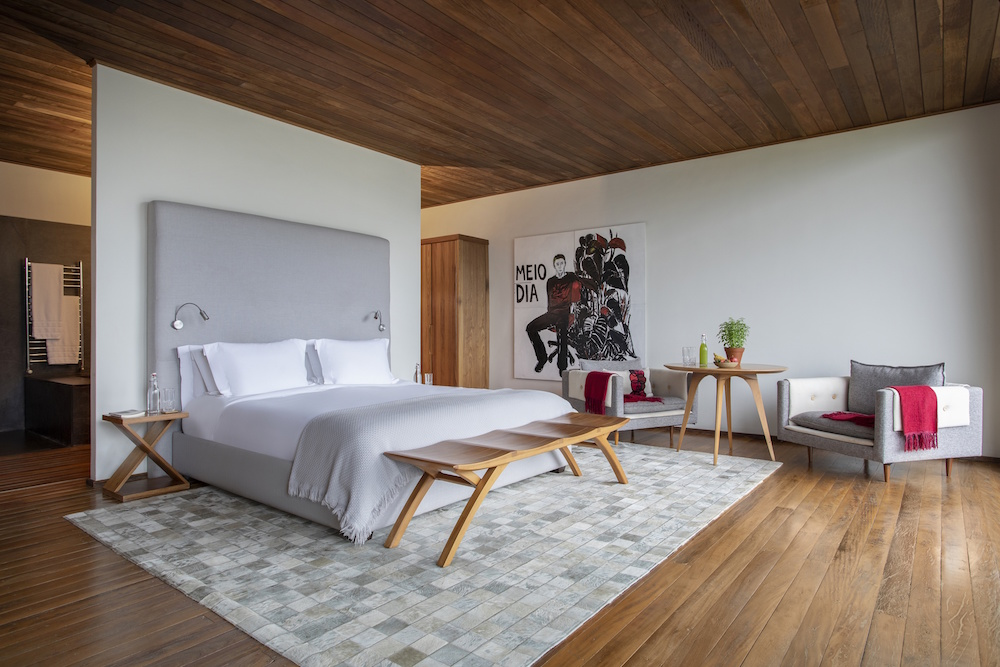 A large luxurious guestroom in a suite inside the Six Senses Hotel