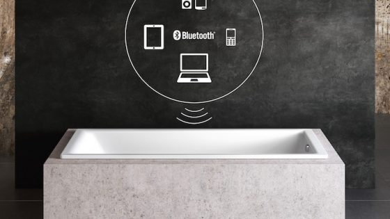 Image of white bath annotated with device logos