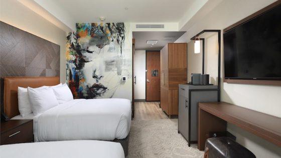 Artful guestroom inside The Glenmark Hotel