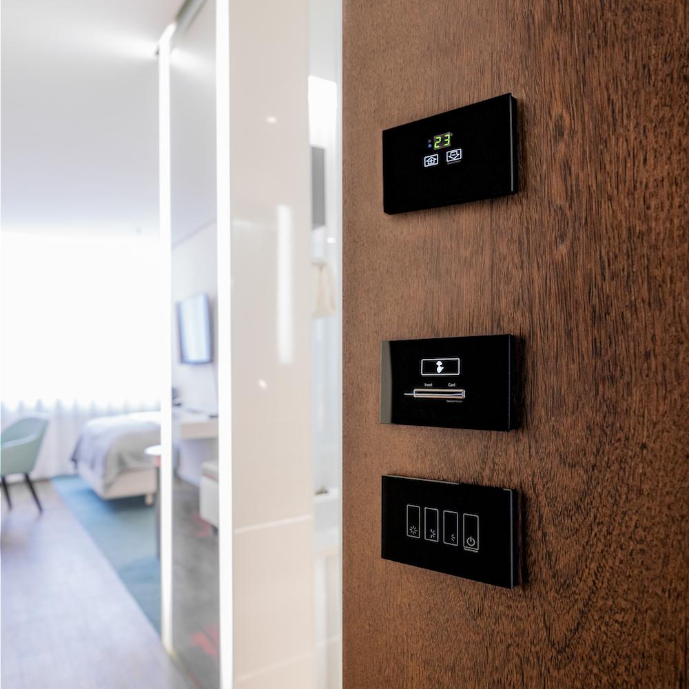Image of digital key card system in hotel door