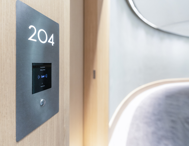 Image of digital hotel technology room entry in corridor