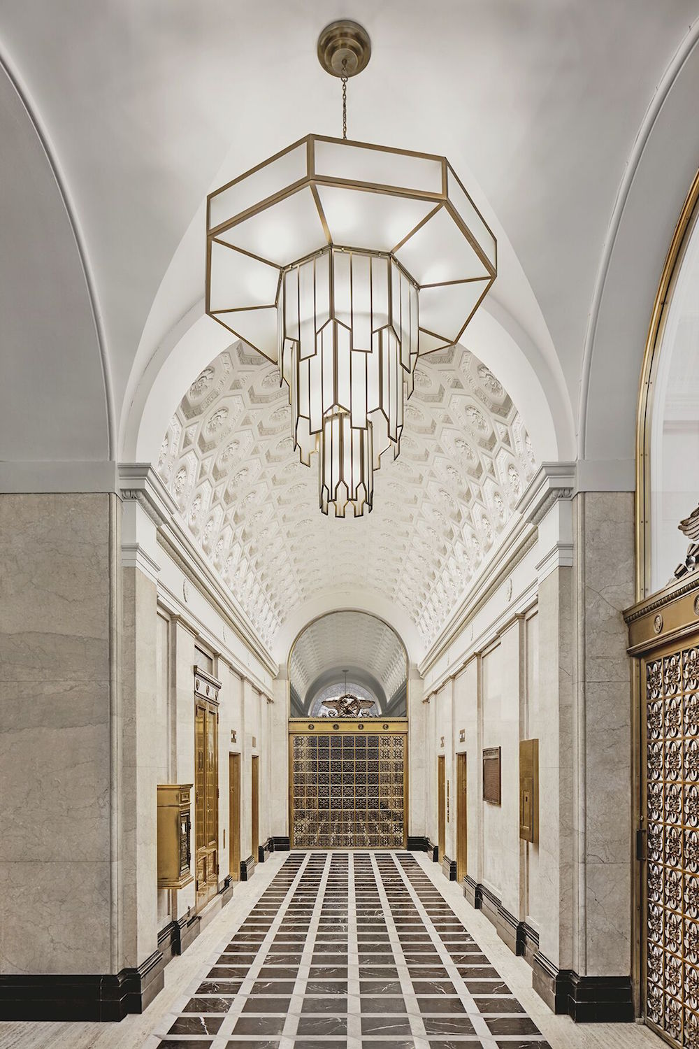 Image caption: The hotel's high-vaulted ceilings were blank canvas' for Jacu Strauss' vision for a bold, inviting entrance into the hotel. | Image credit: Riggs Washington D.C.