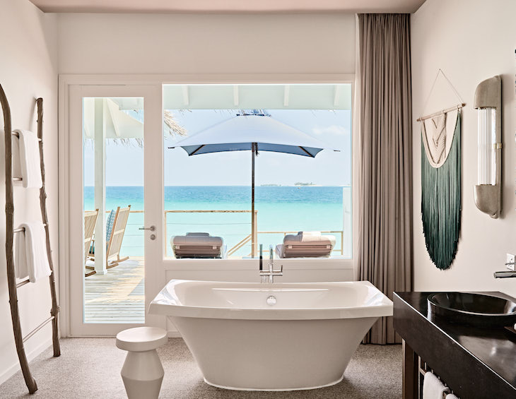 Image of villa overlooking sea from bathroom
