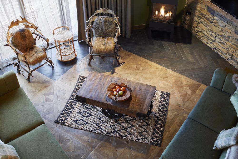 Image caption: Wooden floors inside room at Ramside Treehouses | Image credit: Havwoods