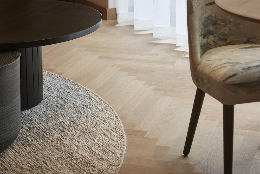 Image caption: Close-up of wooden floors inside Storrs Hall | Image credit: Havwoods