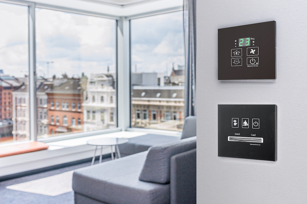 Image of slick tech system in modern hotel room