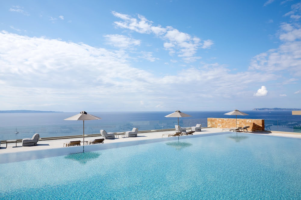 Image of luxury pool and sea at design hotel
