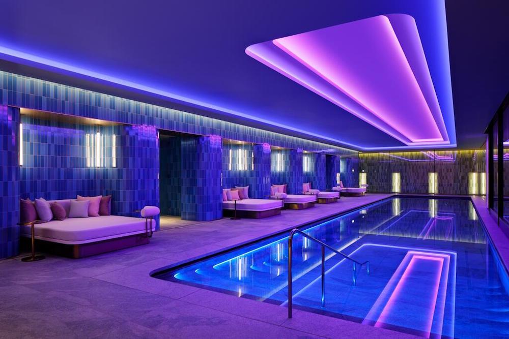 Purple-lit pool inside W Osaka