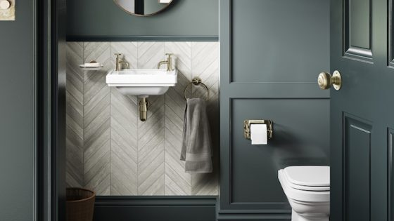 image of mid-tone green bathroom with white and gold basin