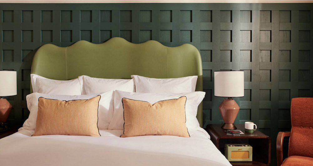 Custom green semi-aniline leather with a smooth finish by Fameed Khalique used at The Hoxton Rome to create statement headboards.