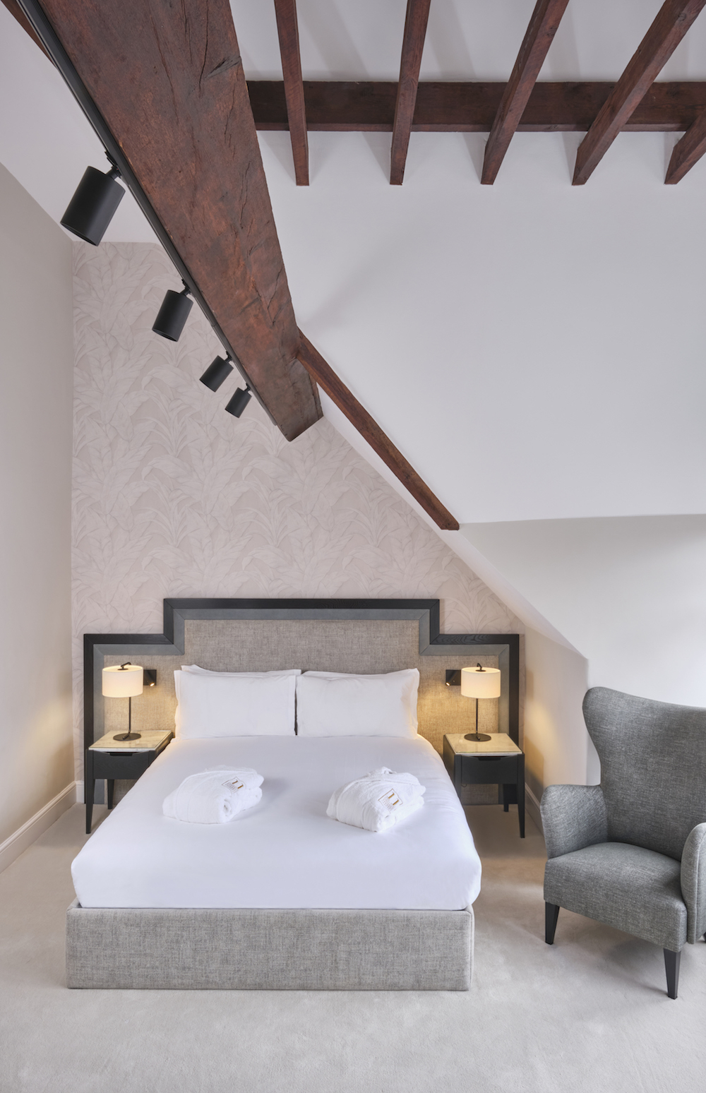 image of double bed in high beiling with wooden beams